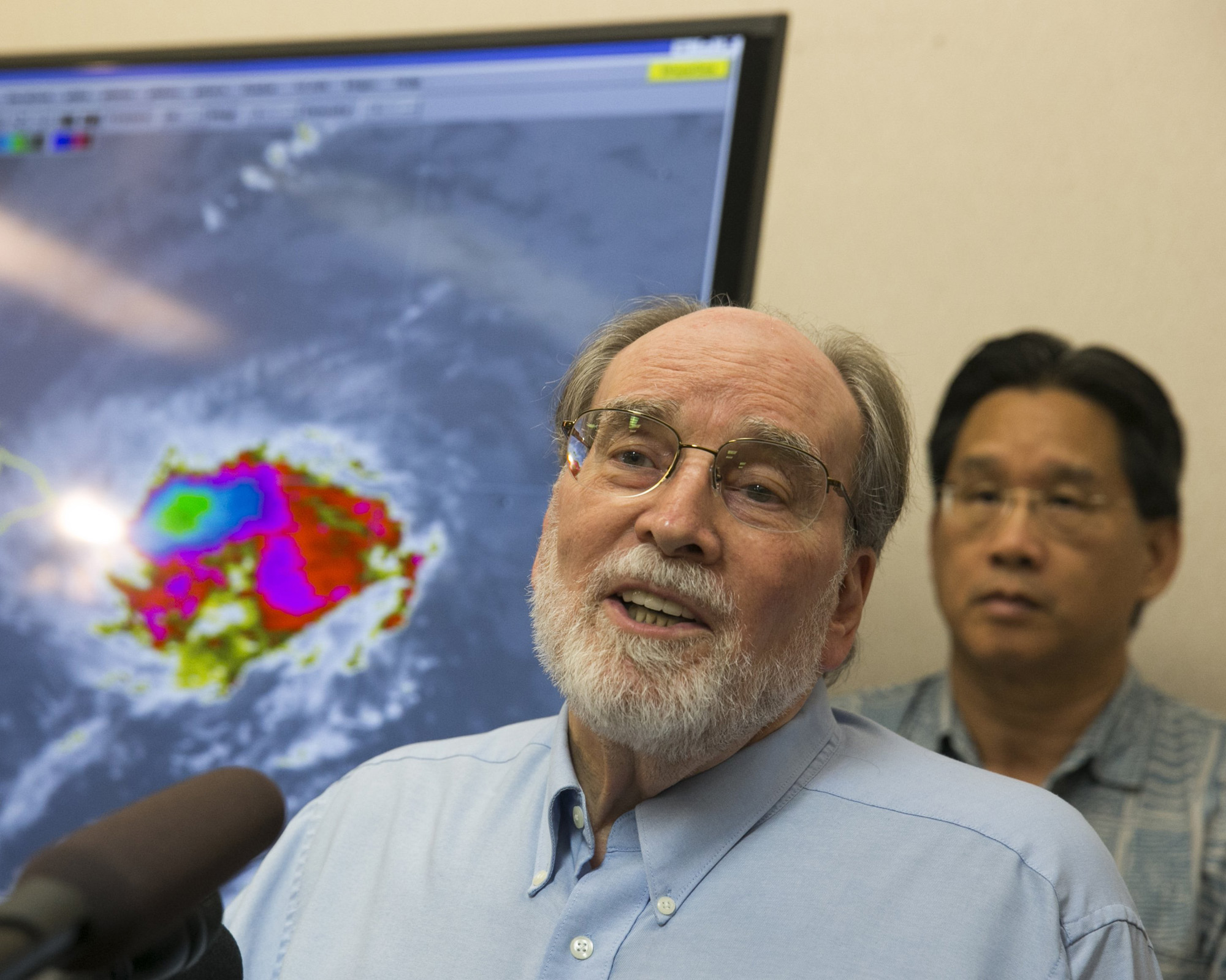 Hawaii Gov. Neil Abercrombie, center, speaks at the National Weather Service office on the campus of the University of Hawaii, Aug. 7, 2014, in Honolulu.