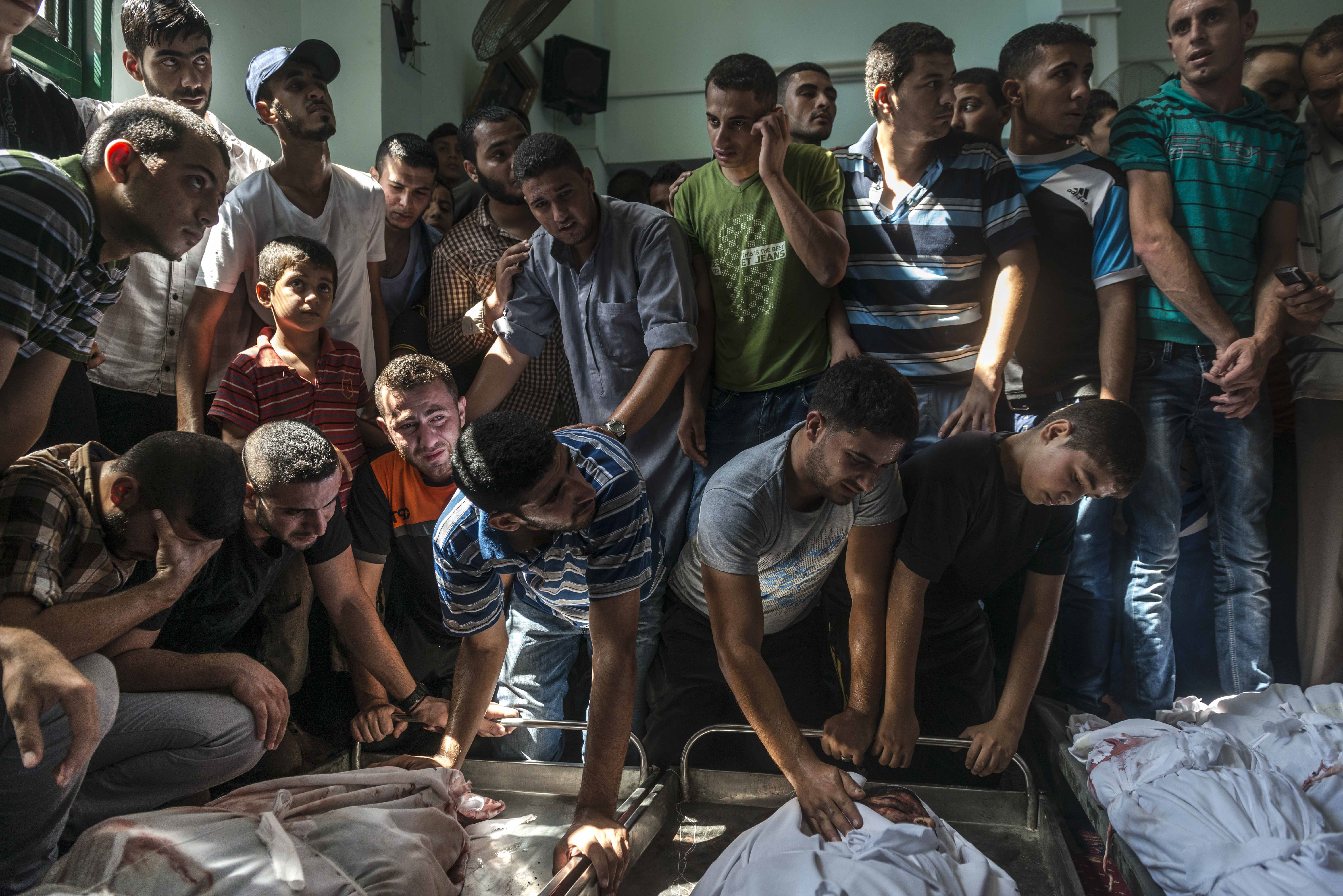 Aug. 4, 2014. Palestinians mourn over the Nigim family, reportedly killed in an airstrike in Jabaliya on the Gaza Strip.