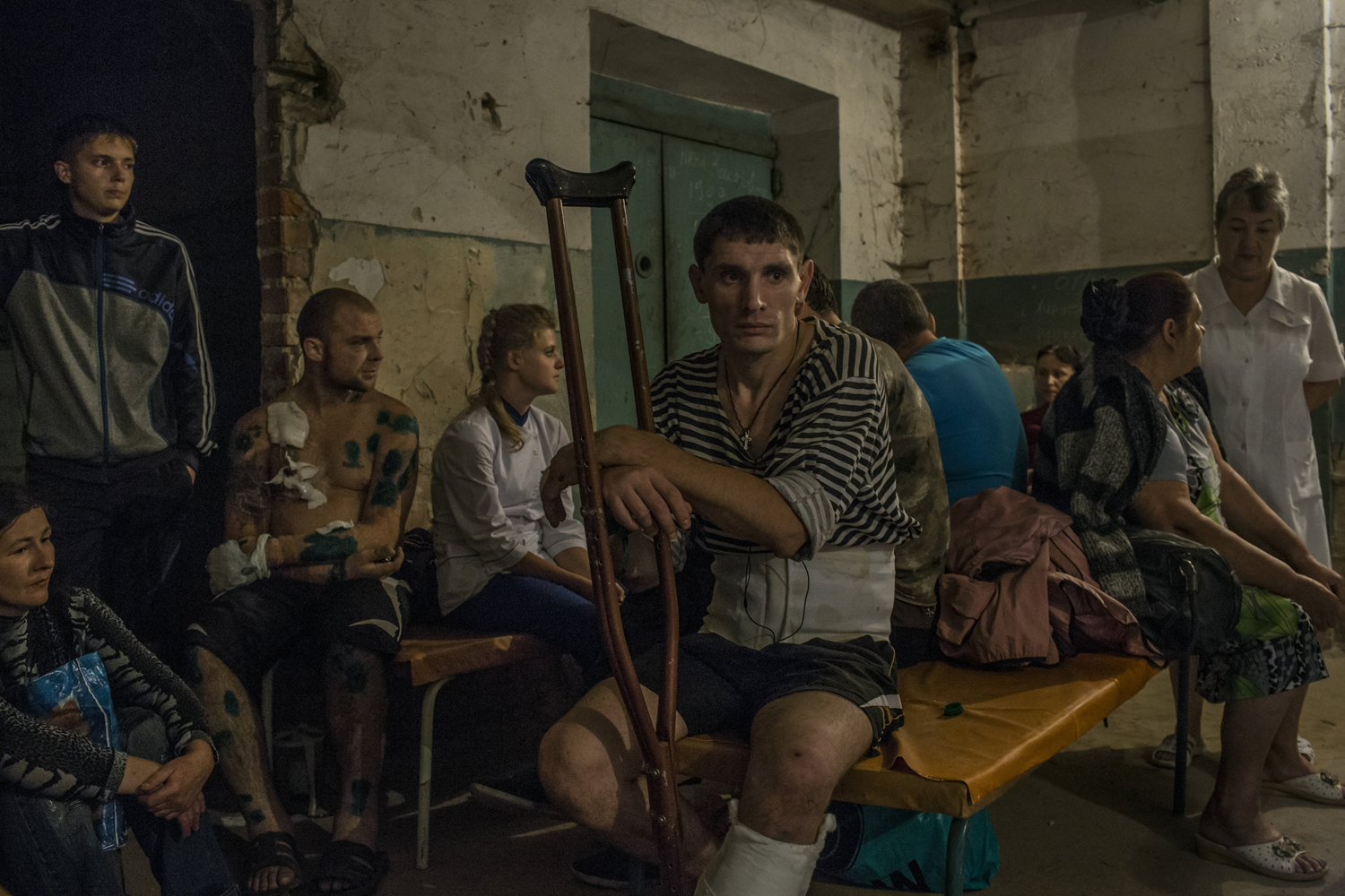 Aug. 24, 2014. Patients and relatives gather in a hospital basement after an early-morning shelling that hit the hospital compound in central Donetsk, Ukraine.