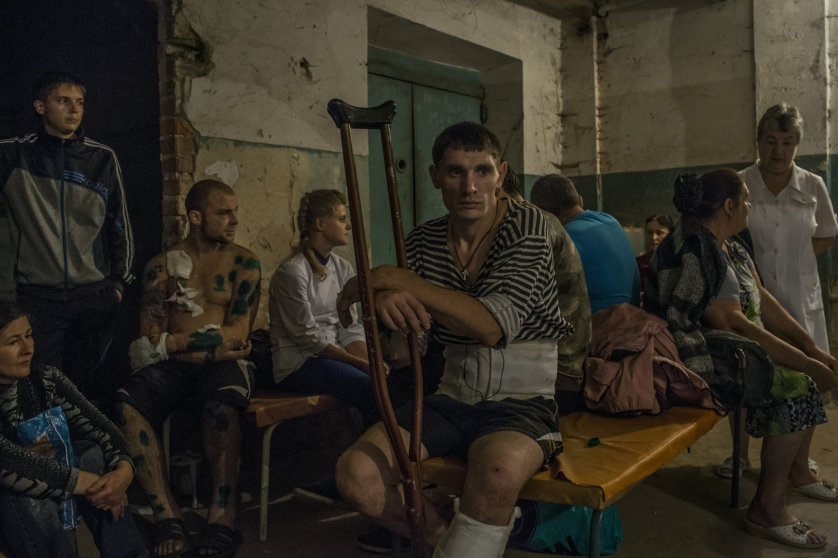 Patients and relatives gather at a hospital basement after an early-morning shelling that hit the hospital compound in central Donetsk, Ukraine