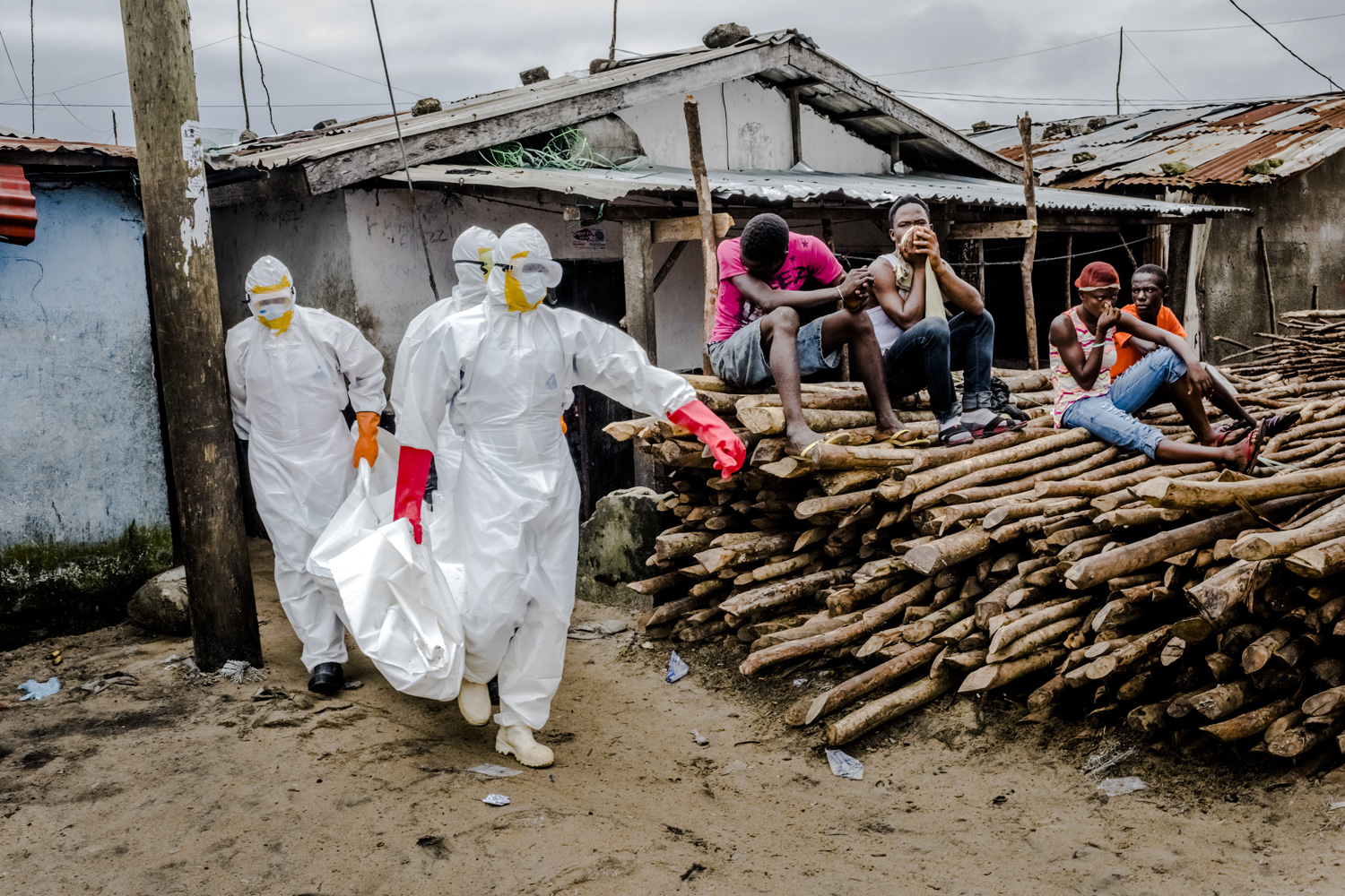 August 28, 2014. A burial team in protective clothing removes the body an Ebola victim from an isolation ward in the West Point neighborhood of Monrovia, the capital of Liberia.