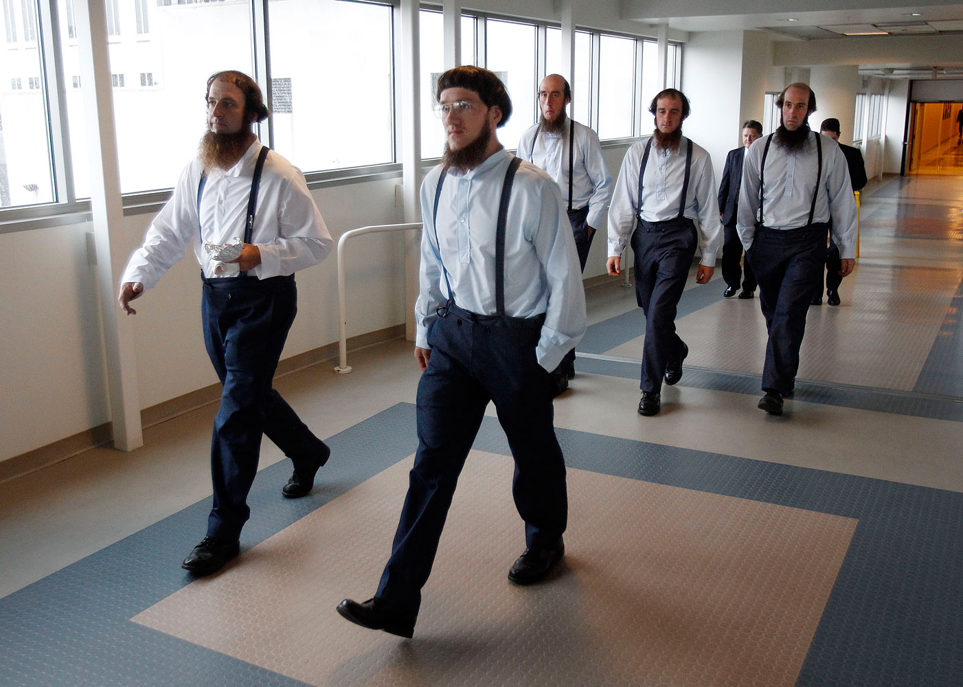 Members of the Amish community leave the Cleveland, Ohio federal courthouse during the trial of a breakaway Amish community in eastern Ohio, led by Samuel Mullet Sr., at the federal courthouse in Cleveland, Aug. 27, 2012.