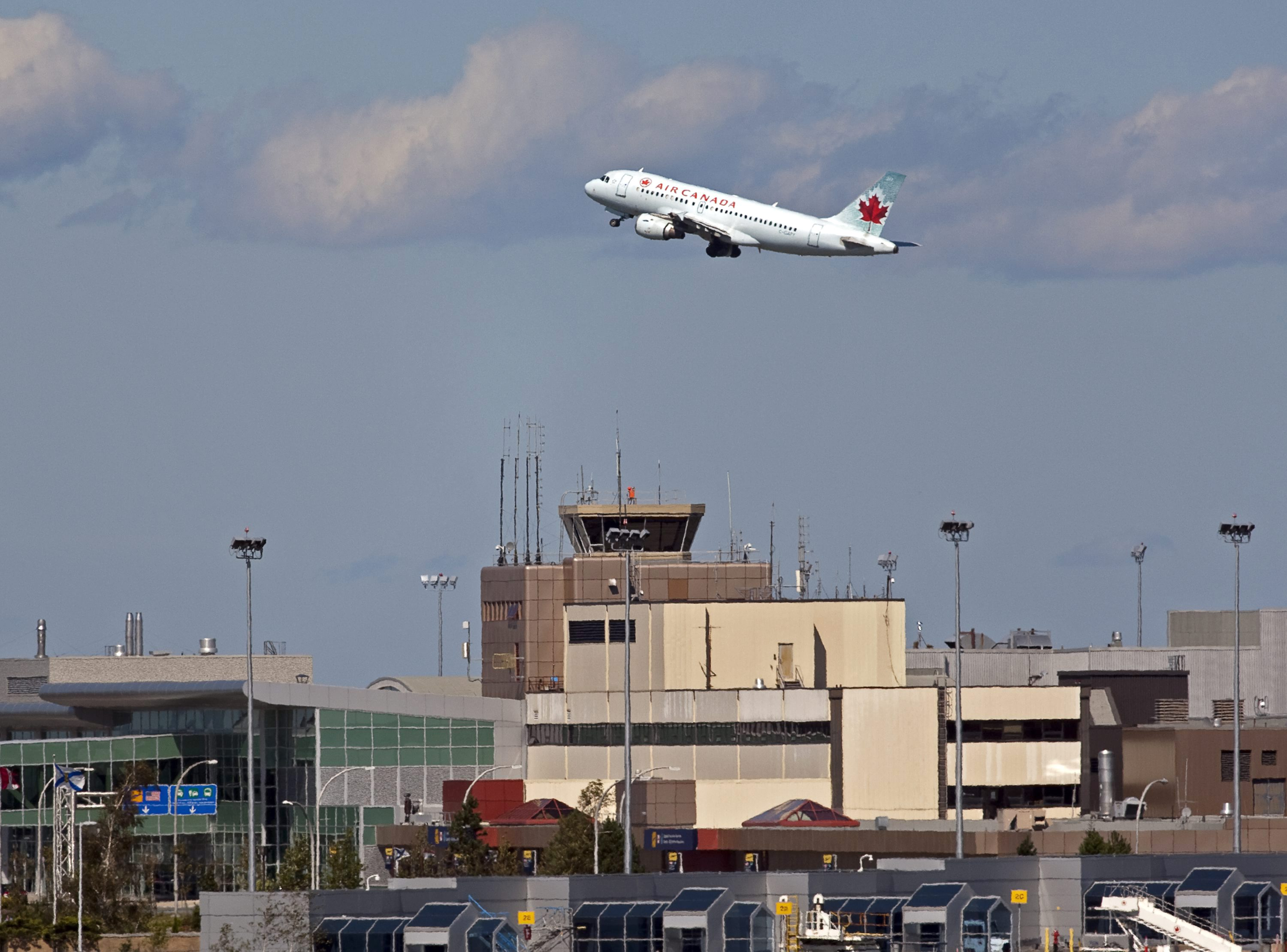 An Air Canada jet takes off over the terminal at the Halifax, Nova Scotia airport on September 12, 2011.