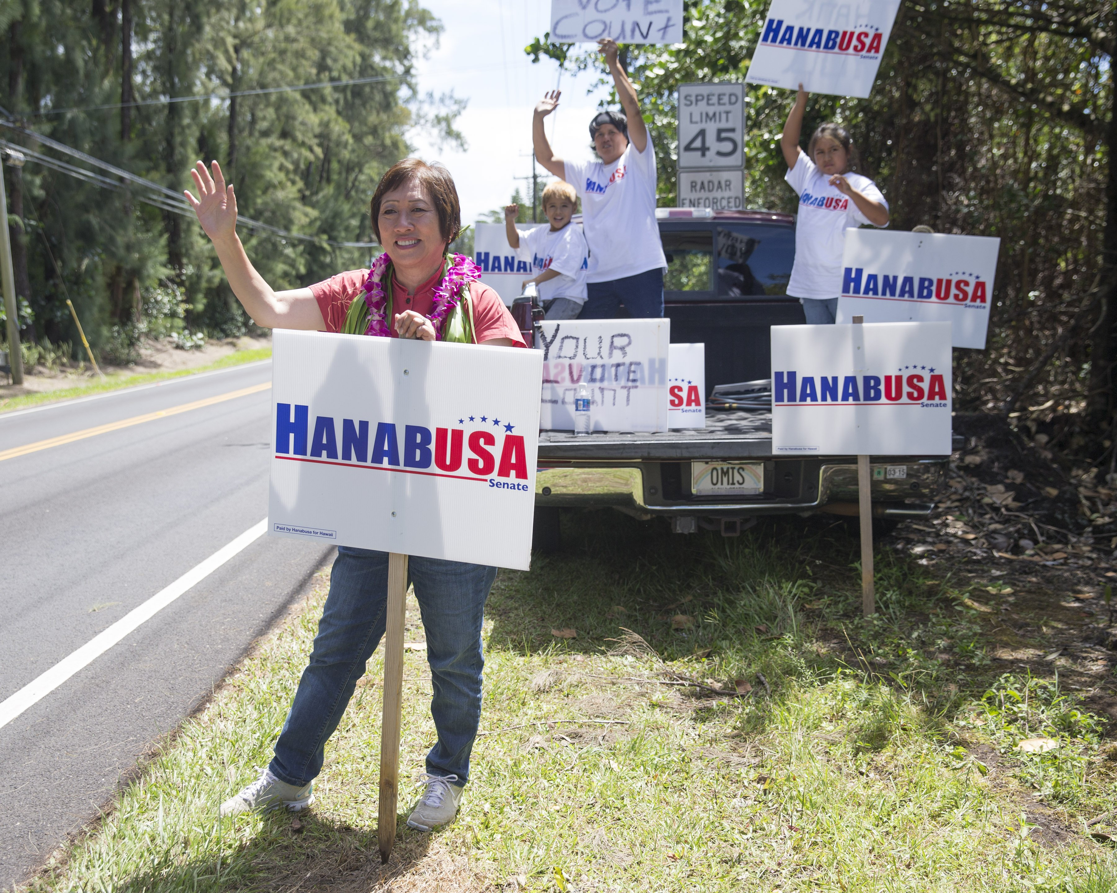 U.S. Rep. Colleen Hanabusa, left, and a group of supporters do some last minute campaigning near the polling place on Aug. 15, 2014, in Pahoa, Hawaii.