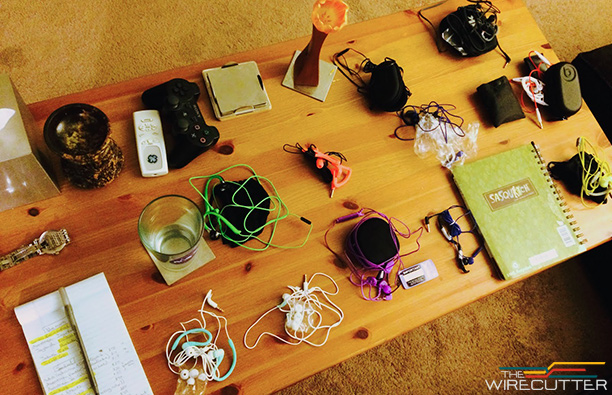 One of the tables full of sport headphones awaiting testing.