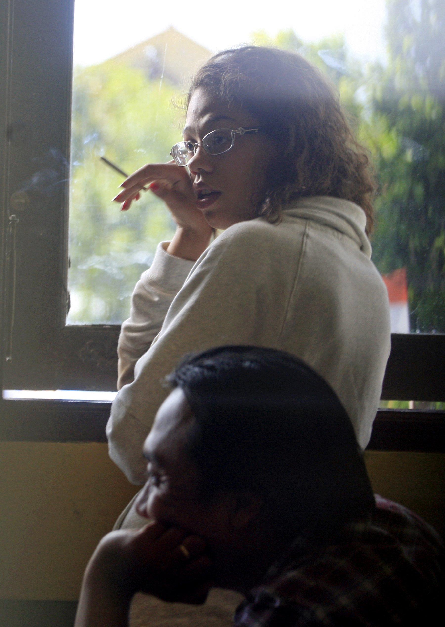 Heather Mack, stands at the police district headquarters after she was brought in for questioning in relation to the death of her mother, in Bali, Indonesia on Aug. 14, 2014.