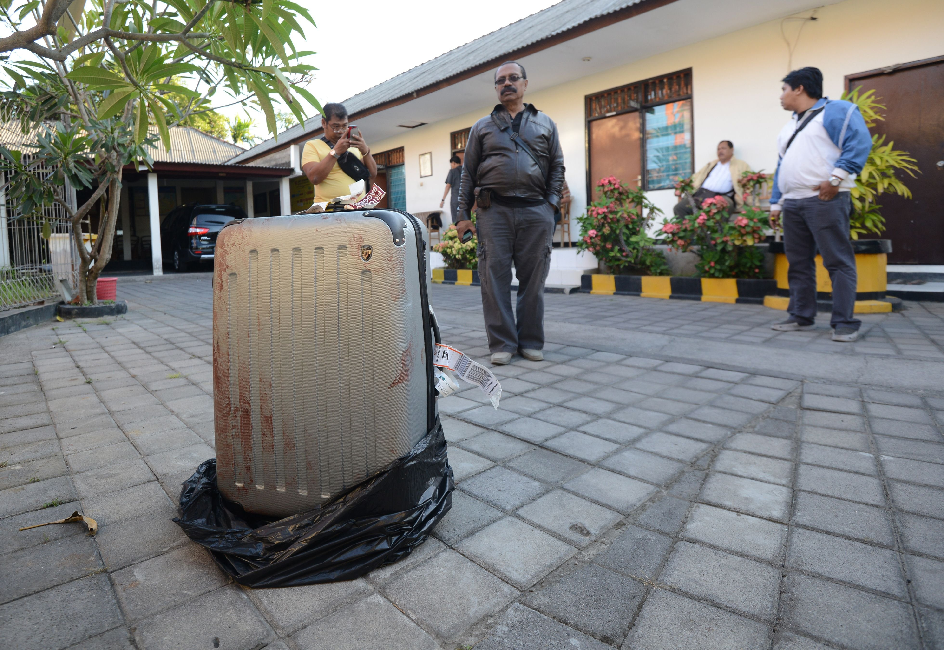 The suitcase where the body of a woman was found inside, displayed at a police station in Nusa Dua on the Indonesian resort island of Bali, Aug. 12, 2014.