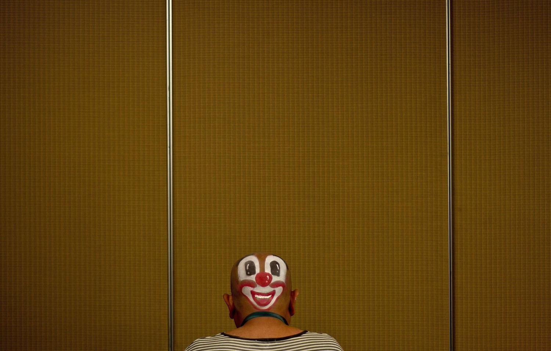 A clown prepares to take part in a Clown Festival in Kuala Lumpur on Aug. 17, 2014.