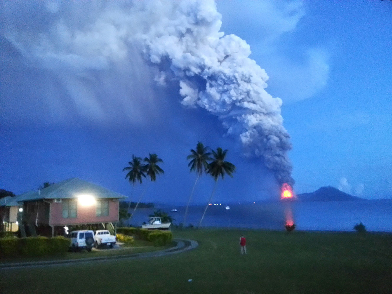A photo taken on August 29, 2014, shows Mount Tavurvur erupting in eastern Papua New Guinea, spewing rocks and ash into the air, forcing the evacuation of local communities and international flights to be re-routed.