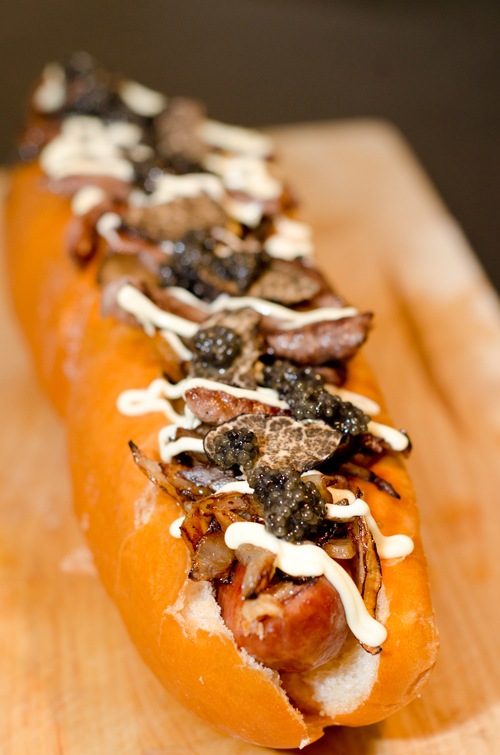 The Juuni Ban contains smoked cheese bratwurst, butter Teriyaki grilled onions, Maitake mushrooms, Wagyu beef, foie gras, shaved black truffles, caviar and Japanese mayonnaise, all on a brioche bun.