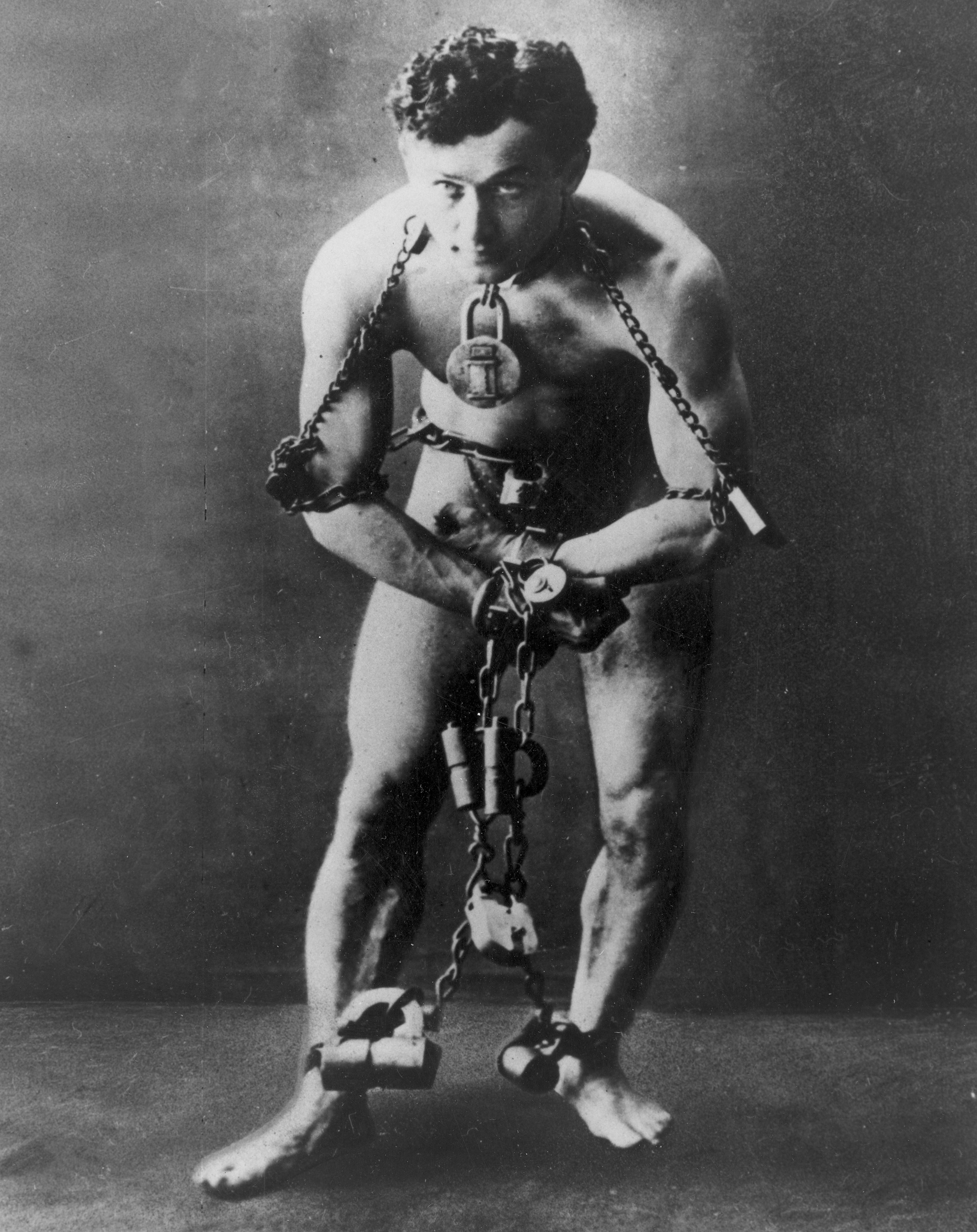 Harry Houdini is shown in chains in this photo circa 1899.