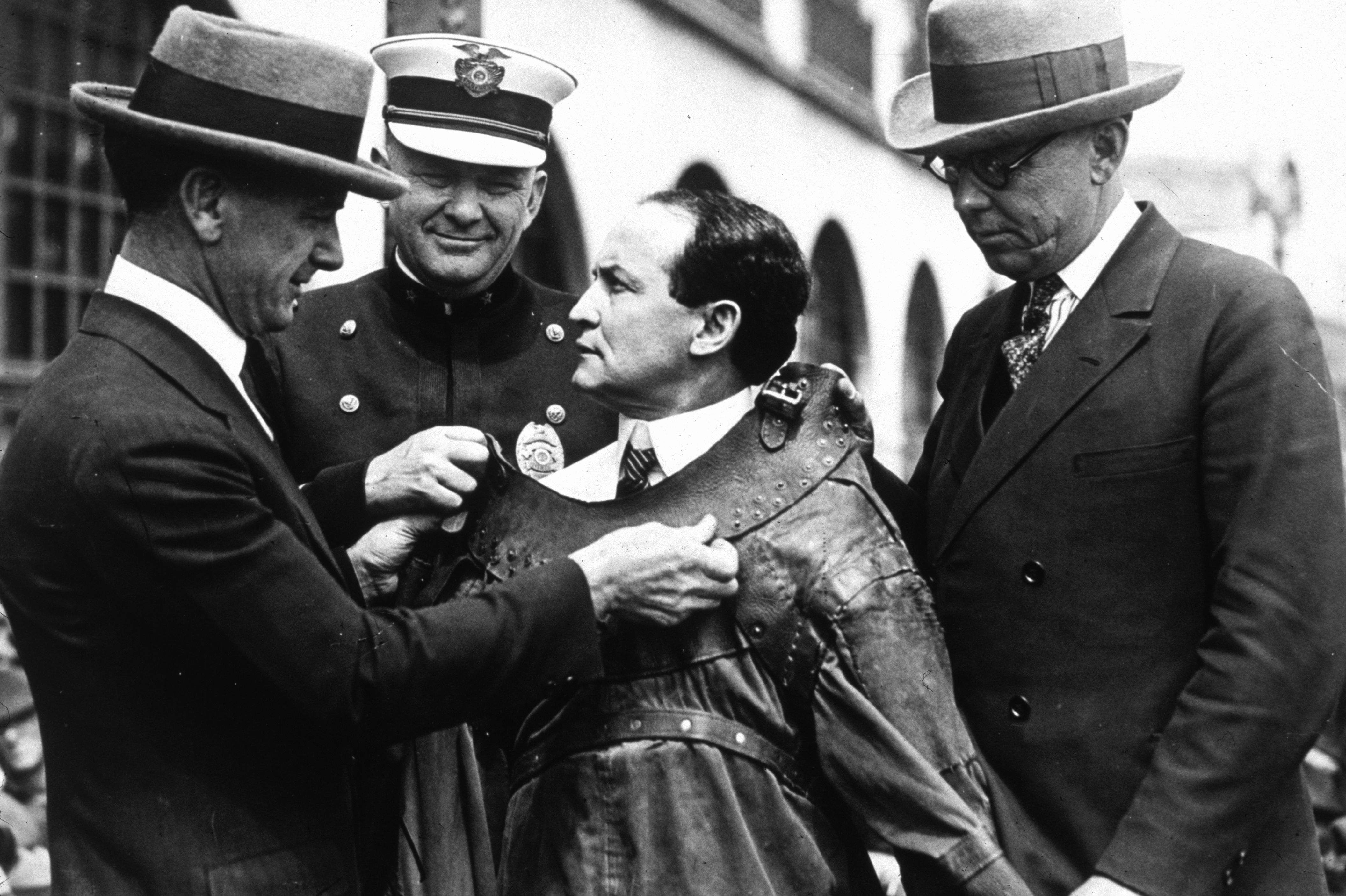 Houdini is seen being fitted into an escape proof suit.