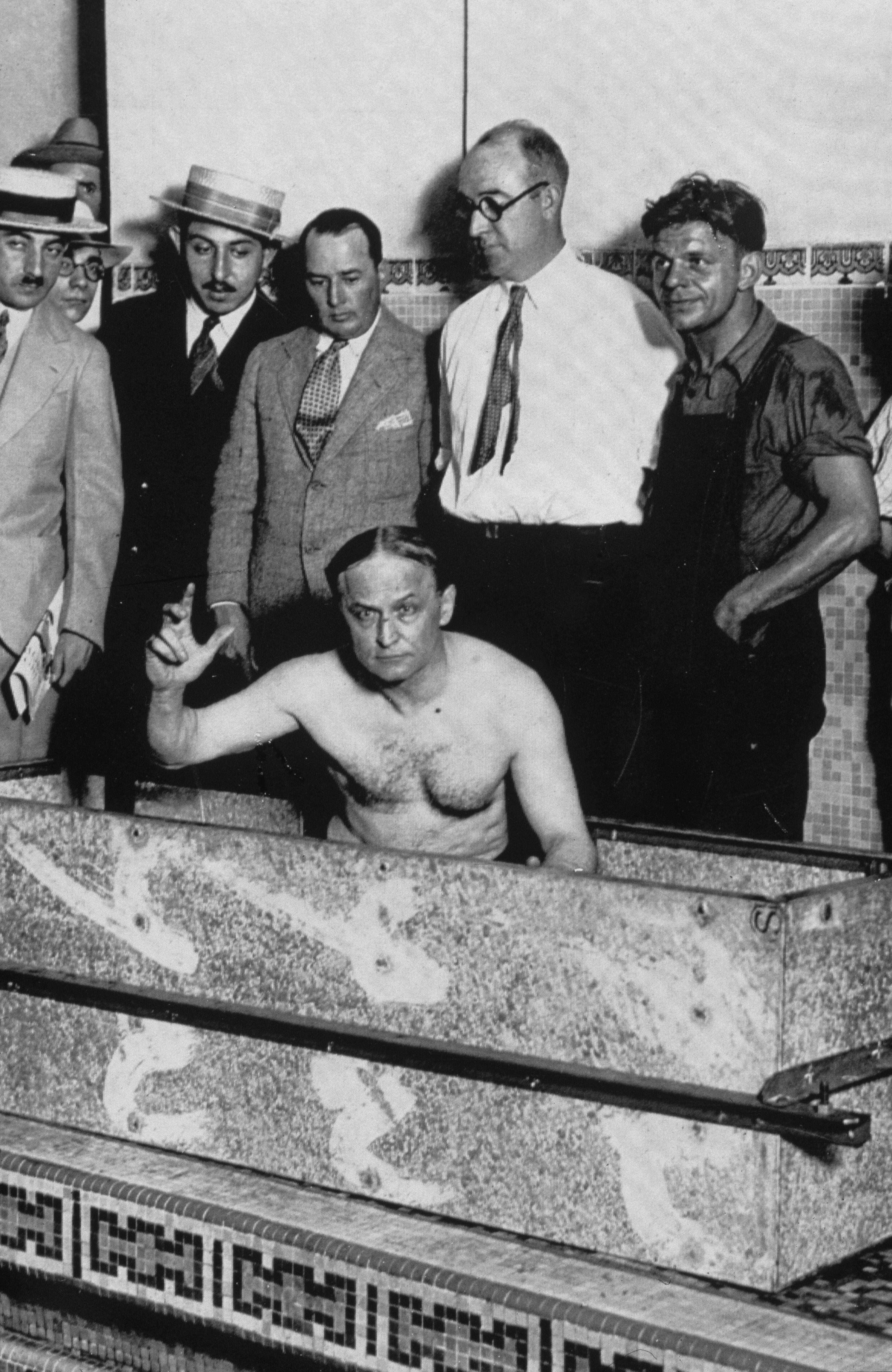 Houdini prepares to be sealed in an airtight casket before being submerged in the pool of the Hotel Shelton in New York, 5th August 1926.