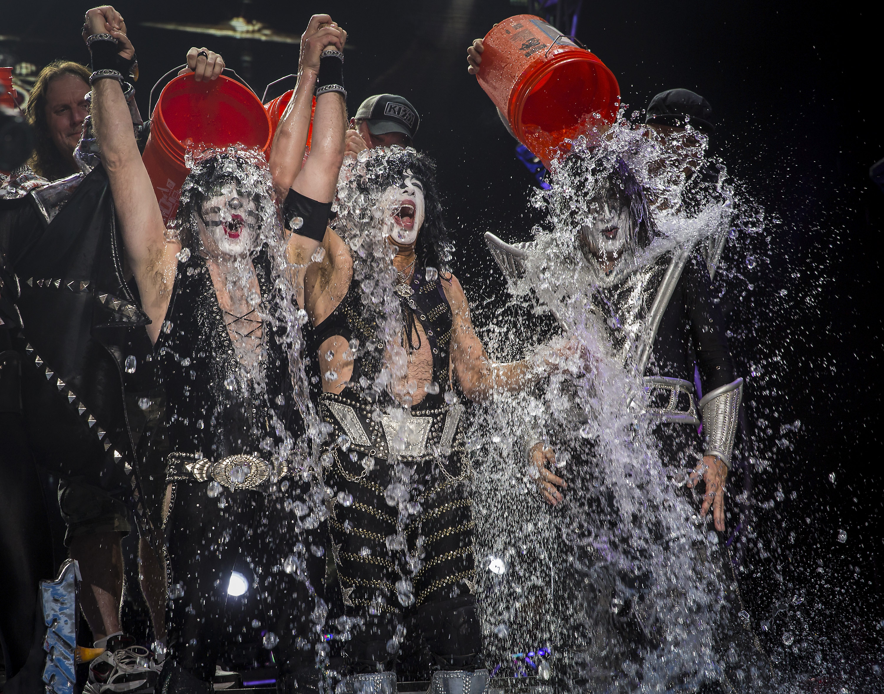 Eric Singer, Paul Stanley and Tommy Thayer of the band KISS participates in the ALS Ice Bucket Challenge at Klipsch Music Center on August 22, 2014 in Noblesville, Indiana.