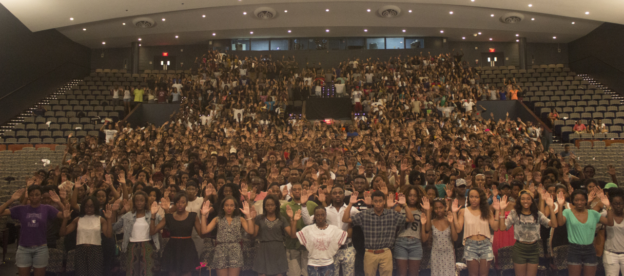 Howard University students pose with their hands raised in Cramton Auditorium in Washington on Aug. 13, 2014.