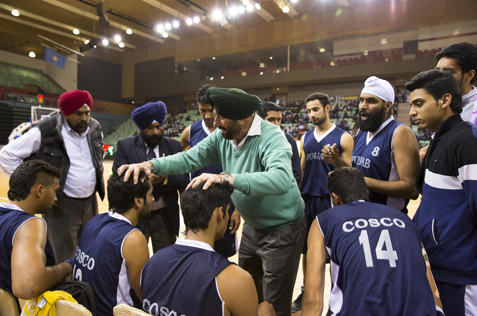 Punjab team time out during their semi-finals match against Tamil Nadu at the 64th Senior National Basketball Championship, Delhi, 2014.