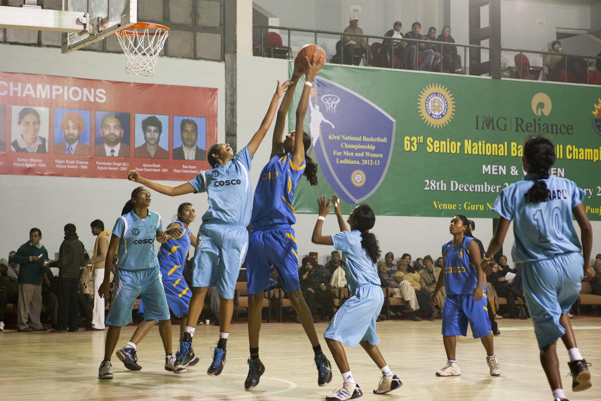 Poonam Chaturvedi 6'11 attacks the basket for team Chattisgarh. Tamil Nadu vs Chattisgarh.   63rd Senior National Basketball Championship, Ludhiana, Punjab, 2013.