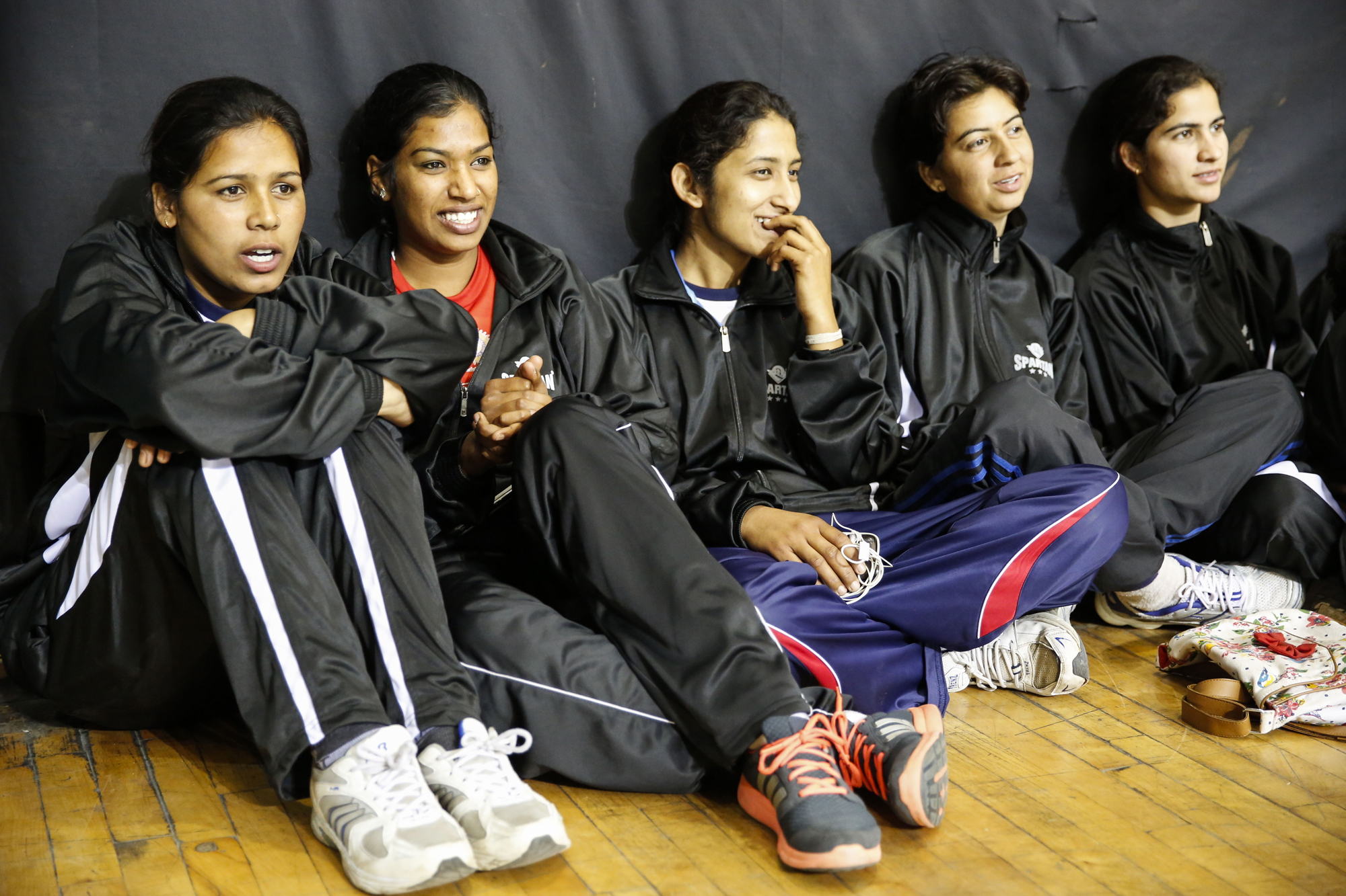 Members of the Rajasthan Women's team watching the action at the 64th Senior National Basketball Championship, Delhi, 2014.