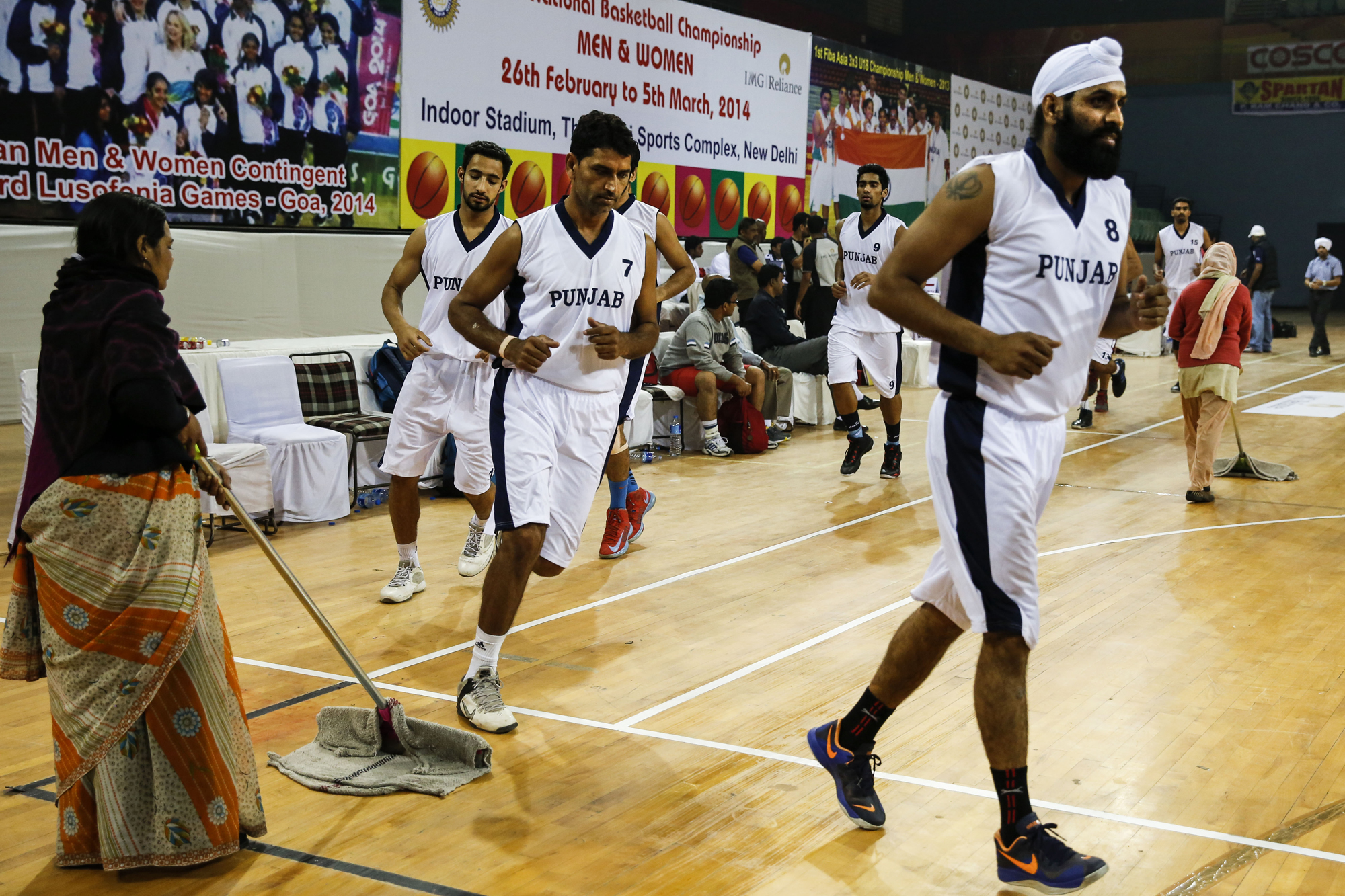 Dhillon Gur leads the Punjab team pre-game warmup up 64th Senior National Basketball Championship, Delhi, 2014