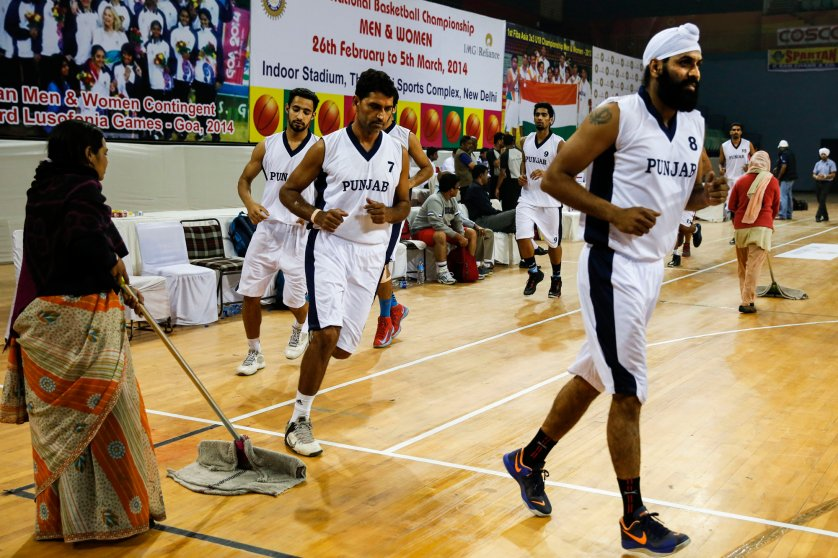 Dhillon Gur leads the Punjab team pre-game warmup up 64th Senior National Basketball Championship for Men and Women, Delhi 2014