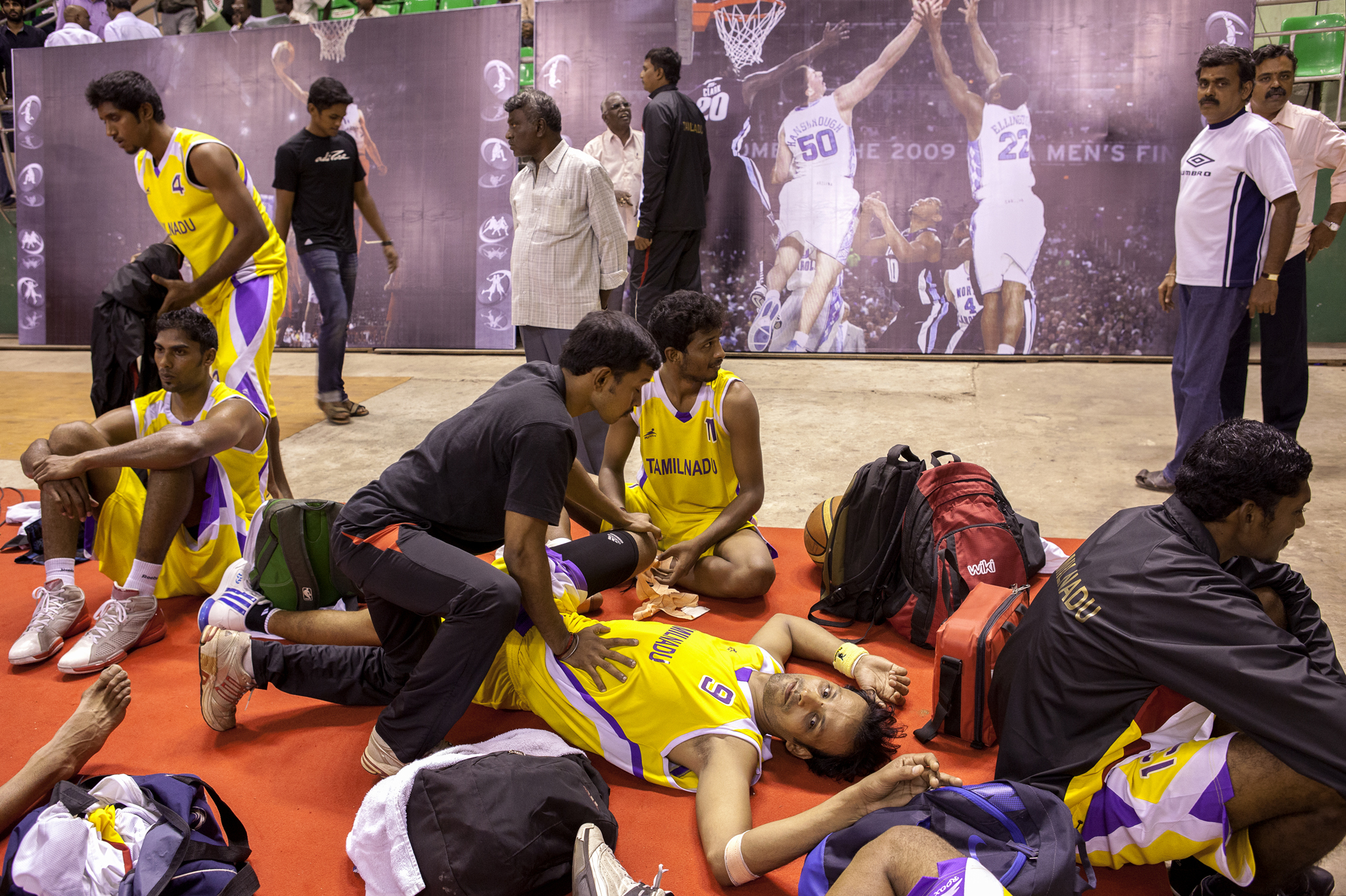 Tamil Nadu team pre game stretch at the 62nd Senior National Basketball Championship, Chennai, Tamil Nadu, 2011.