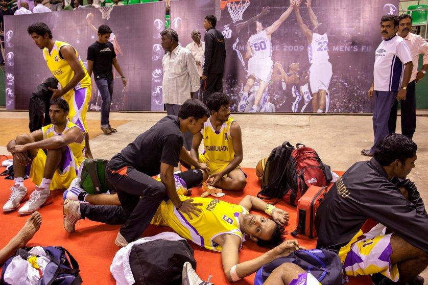 Tamil Nadu team pre game stretch at the 62nd Senior National Basketball Championship for Men and Women, Chennai, Tamil Nadu 2011.