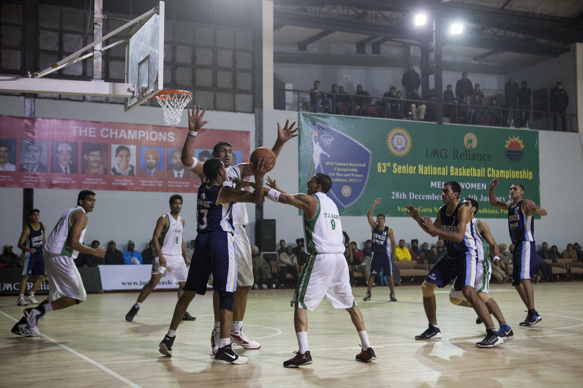 Satnam Singh defending the basket, Punjab team vs Services, 63rd Senior National Basketball Championship, Ludhiana, 2012.
