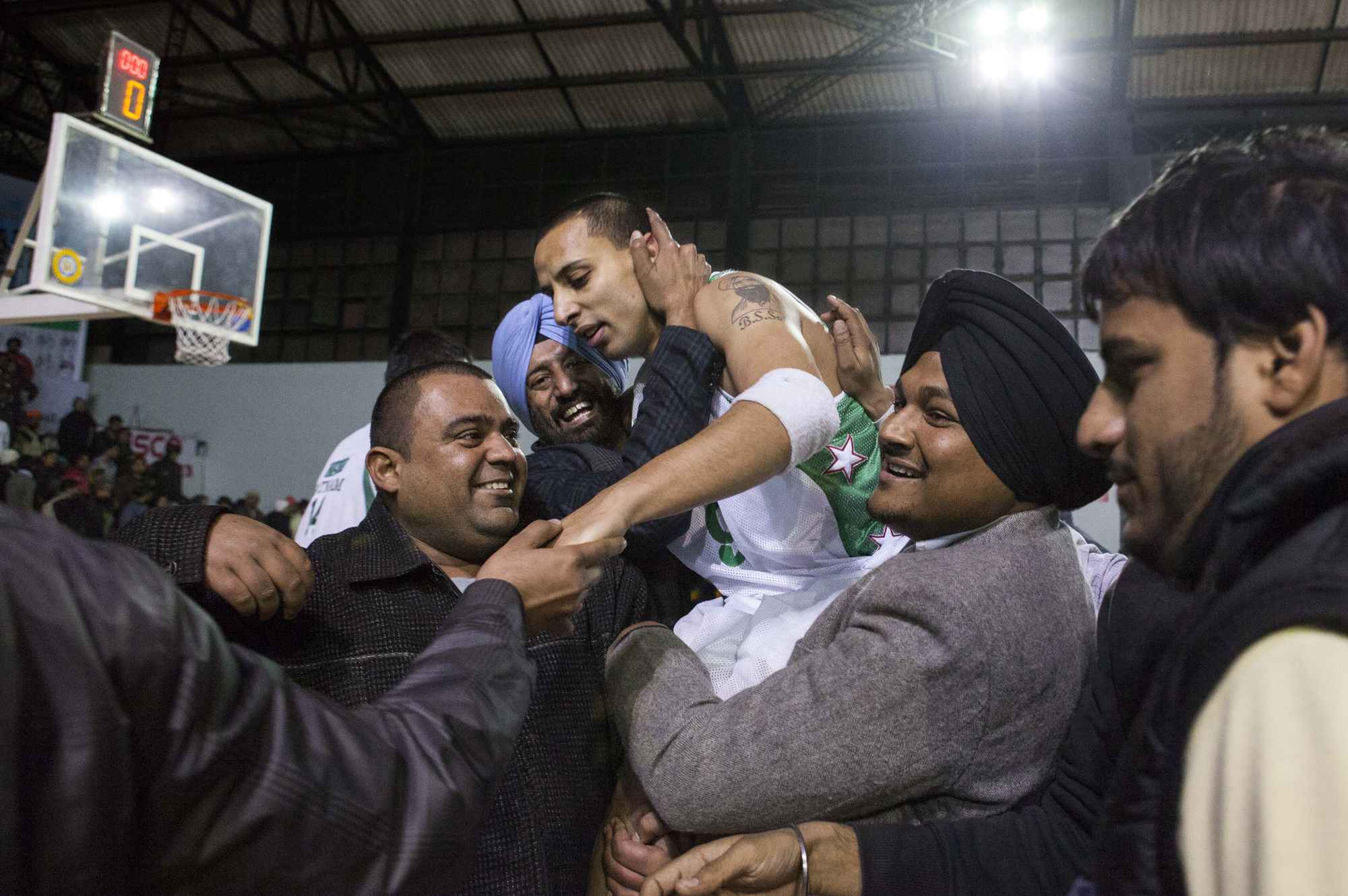 Punjab guard TJ Sahi is lifted by adoring fans in his hometown of Ludhiana, Punjab as they celebrate Punjab's semi-finals victory over Tamil Nadu at the 63rd Senior National Basketball Championship, 2013.