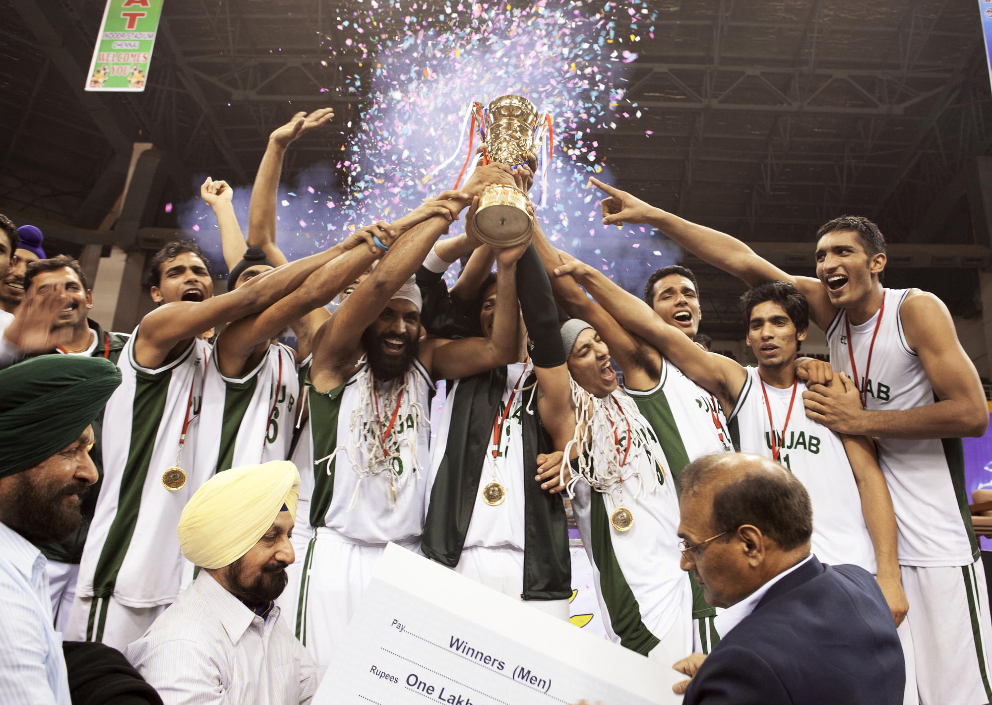Punjab team hoisting the trophy after winning the  62nd Senior National Basketball Championship. Chennai, 2011.
