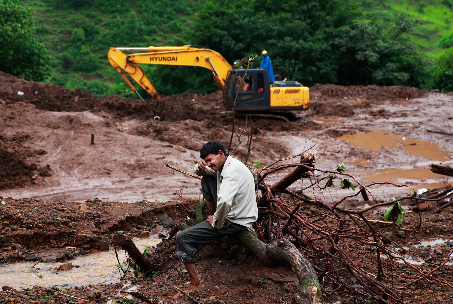Chandrakant Zanjare, who said he lost 13 family members to a landslide, wails near the site where his house stood in Malin village, in the western Indian state of Maharashtra on Aug. 1, 2014.