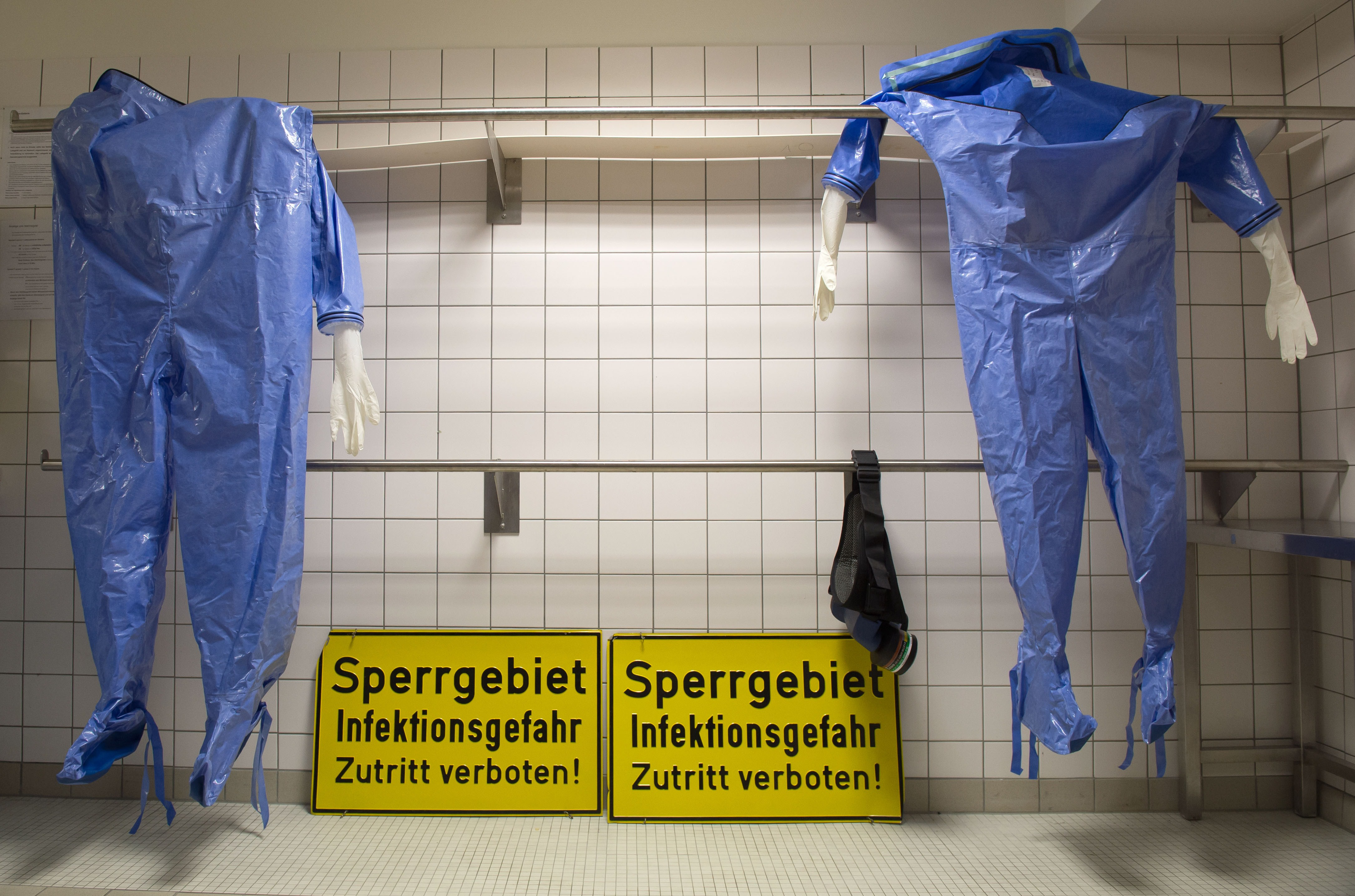 Protective clothing hangs in a changing room of the quarantine office of Berlin's Charite hospital on August 11, 2014.