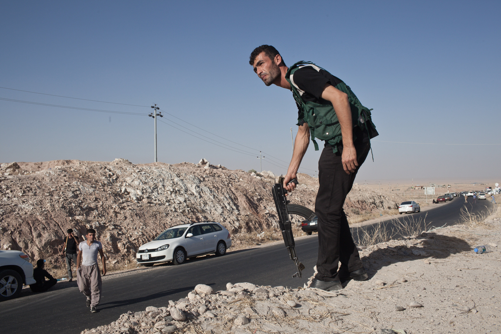 Kurdish military volunteers amass near the frontline at the outskirts of the town of Makhmor, 35 miles south of Erbil, the capital of the Kurdish Region of Iraq, Aug. 9. 2014.