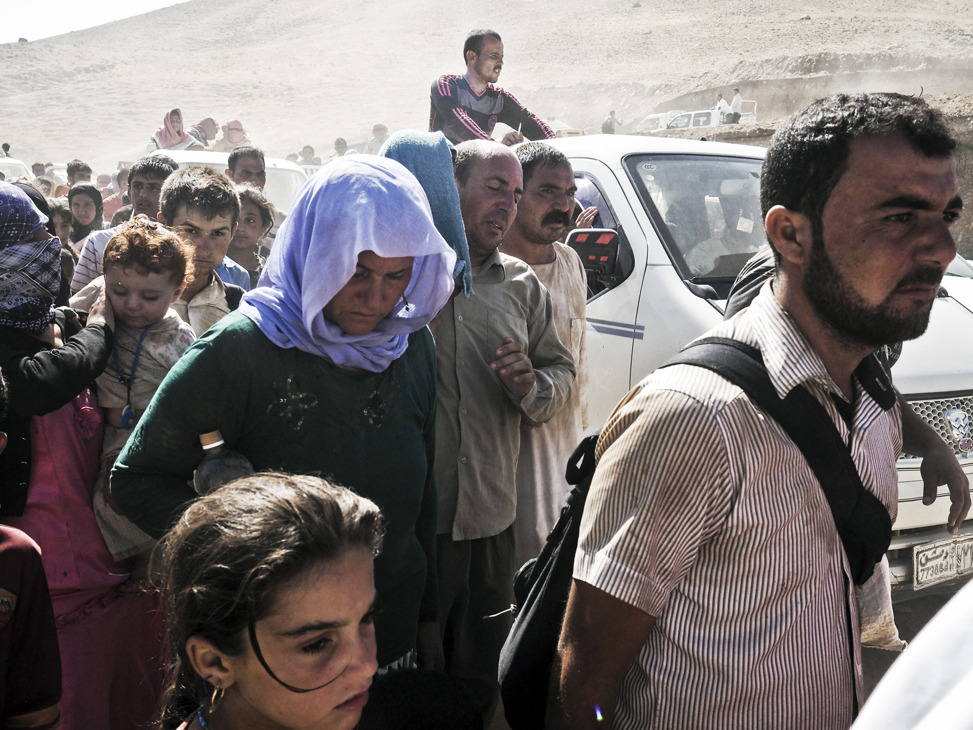 Yazidi families from Sinjar arrive at the Fishkhabur border crossing between Iraq's Dohuk Province and Syria, Aug. 10, 2014.