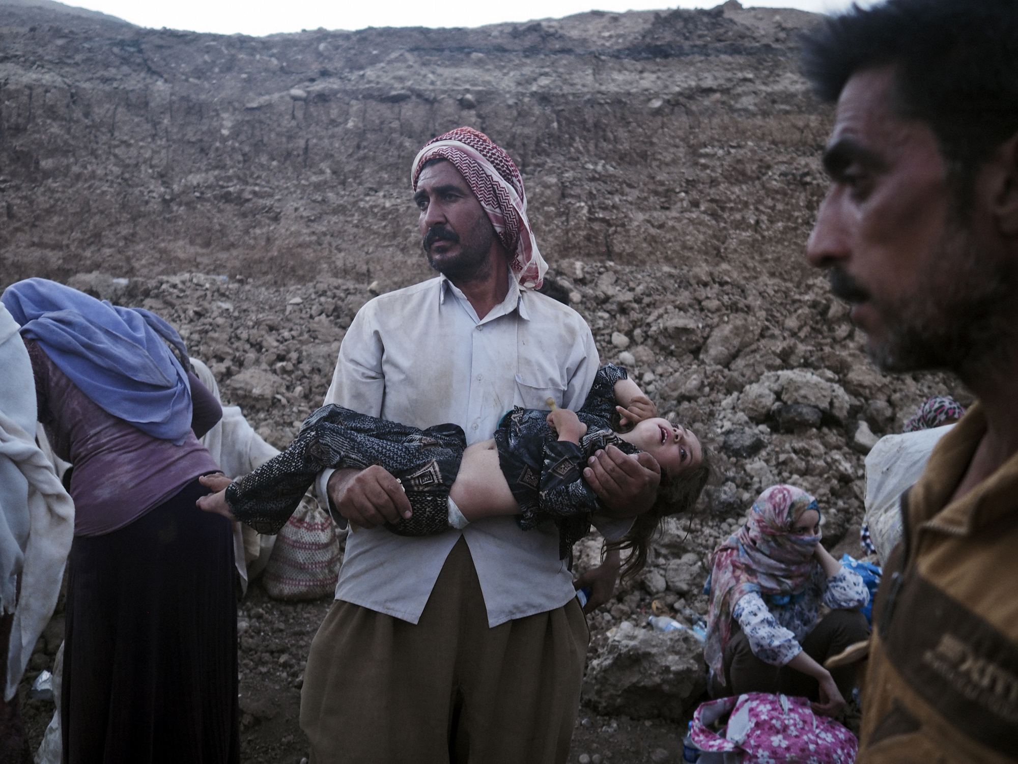 A Yazidi family from Sinjar arrive at the Fishkhabur border crossing between Iraq's Dohuk Province and Syria, Aug. 10, 2014.