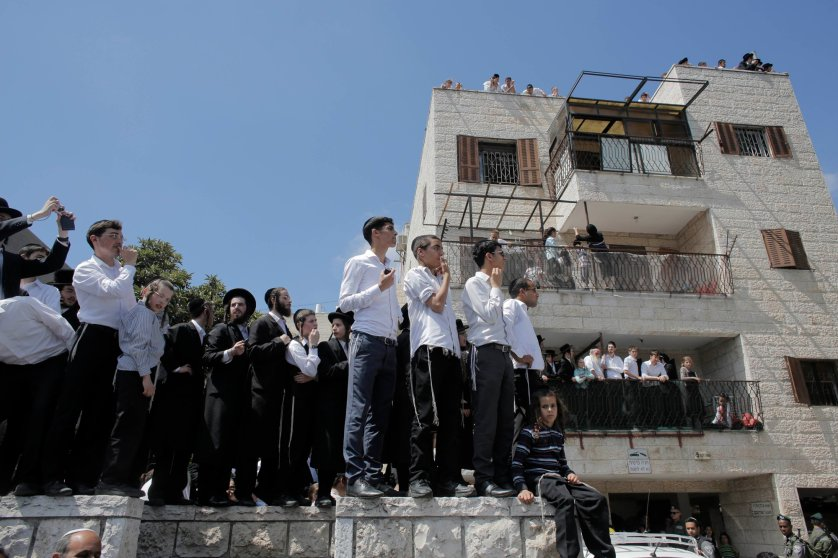 Residents gather at the scene of a suspected attack in Jerusalem, Aug. 4, 2014.