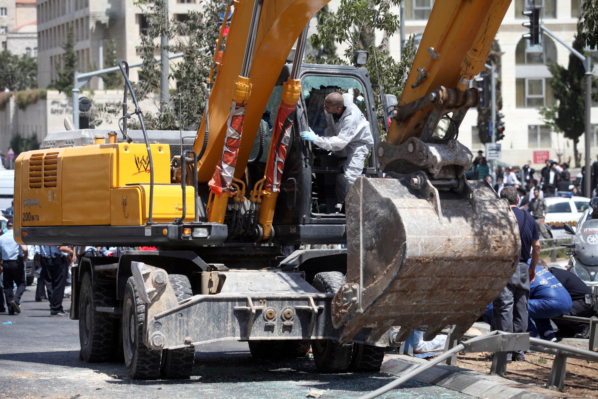 Israeli forensic police inspect the bulldozer at the scene of attack in Jerusalem,  Aug. 4, 2014.