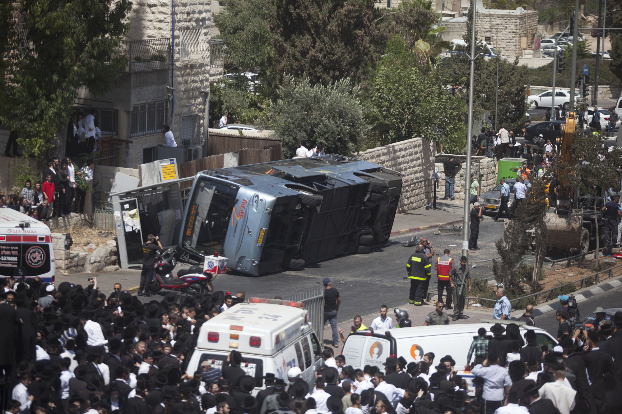 A bus after a Palestinian man in an excavator rammed into it on Aug. 4. 2014 in Jerusalem.