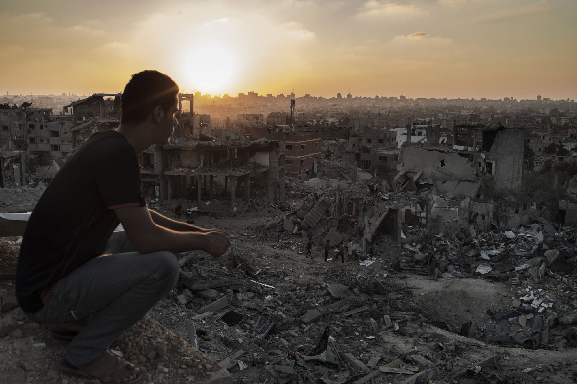 A Palestinian man looks at heavy destruction during a 72 hours cease-fire in Al Shaaf neighborhood of Gaza City on Aug. 11, 2014