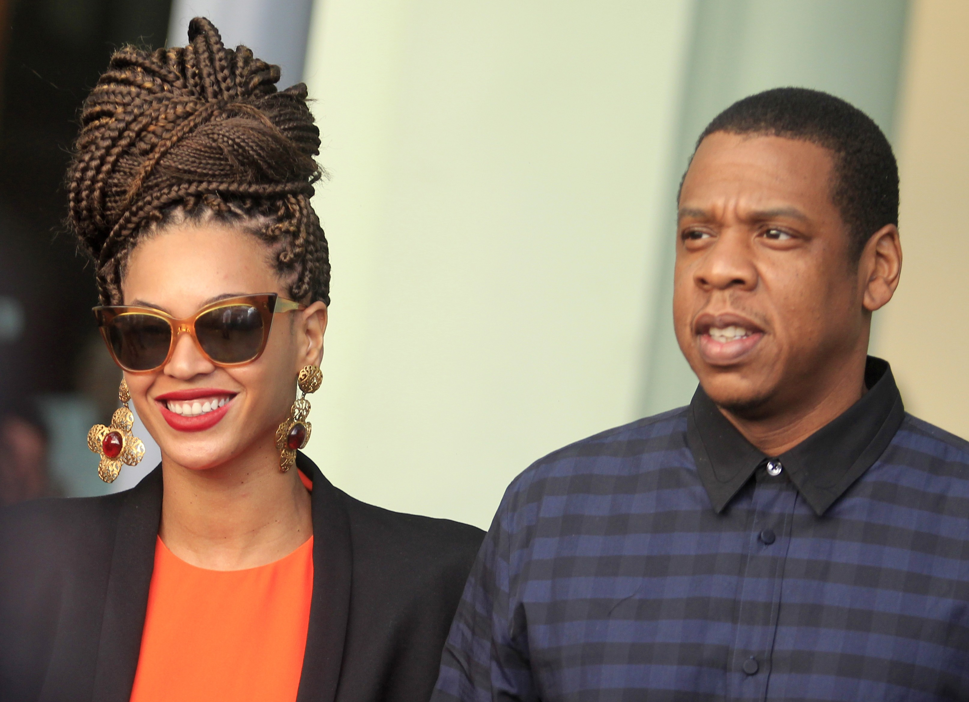 U.S. singer Beyonce and her husband rapper Jay-Z walk as they leave their hotel in Havana on April 4, 2013.