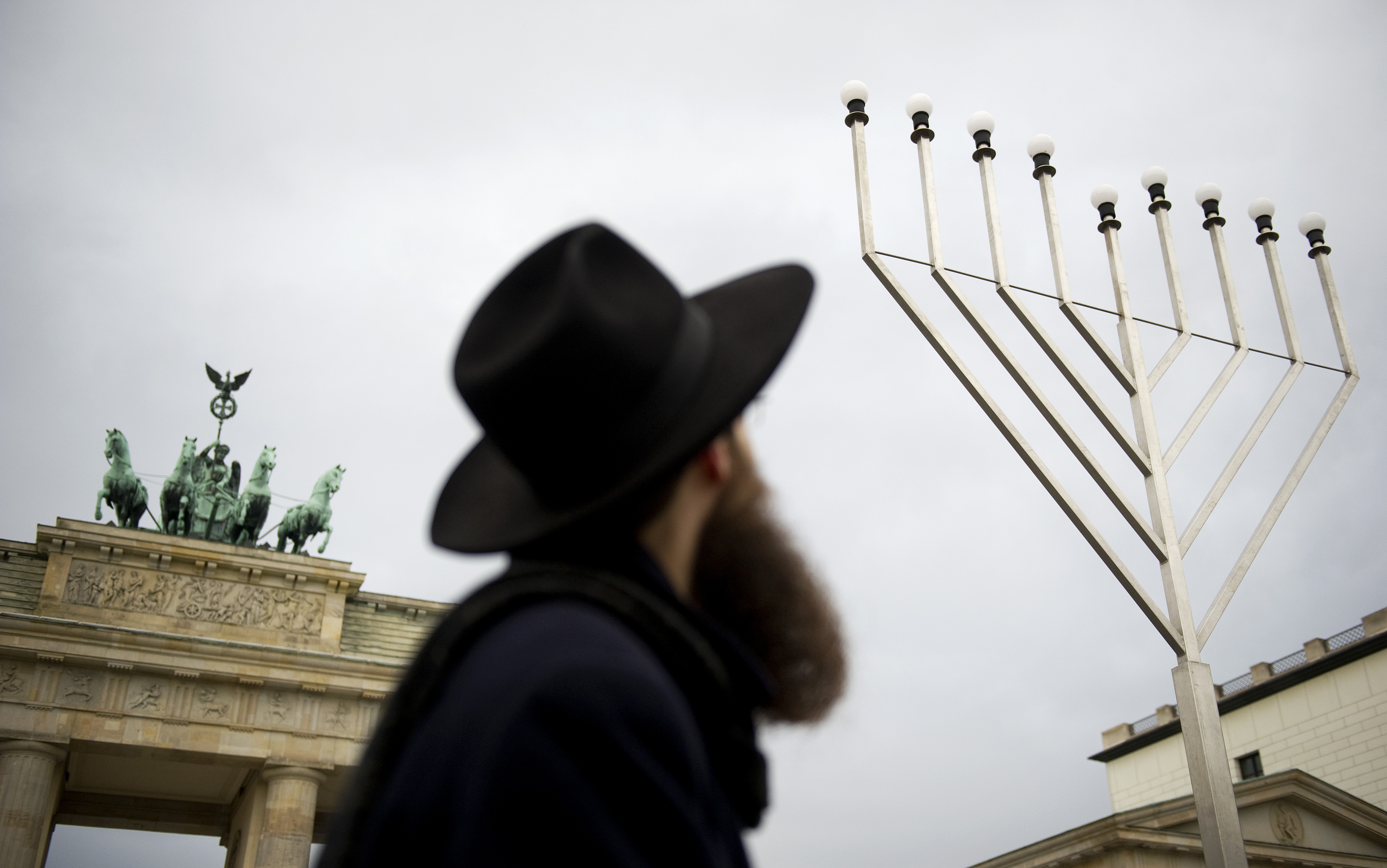 Rabbi Shmuel Segal of the Jewish education centre looks up at the Chanukkah lights in front of Brandenburg Gate in Berlin, December 20, 2011.