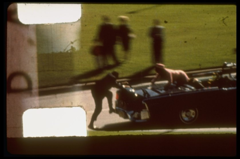 Zapruder film frame #372 of Kennedy assassination showing Mrs. Kennedy climbing towards Secret Service agent who is attempting to board back of limousine after Pres. Kennedy has been shot. Dallas. United States. Nov. 22, 1963.