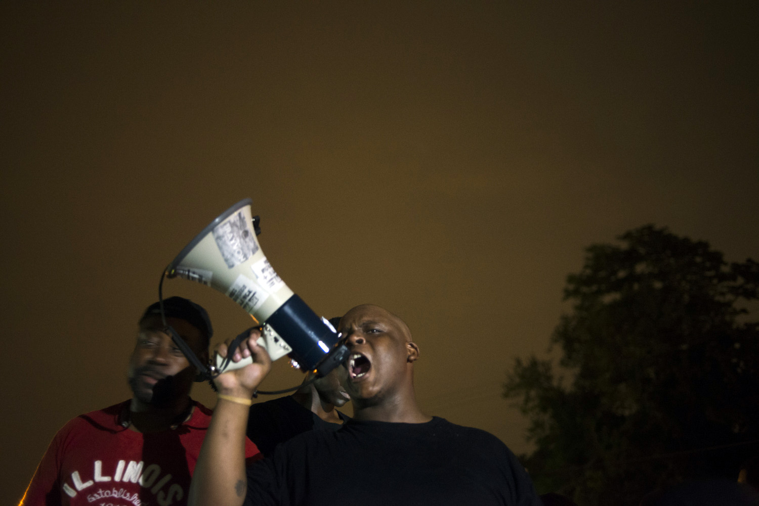 A demonstrator protests on Florissant Ave in Ferguson, Mo. on Aug. 16, 2014.