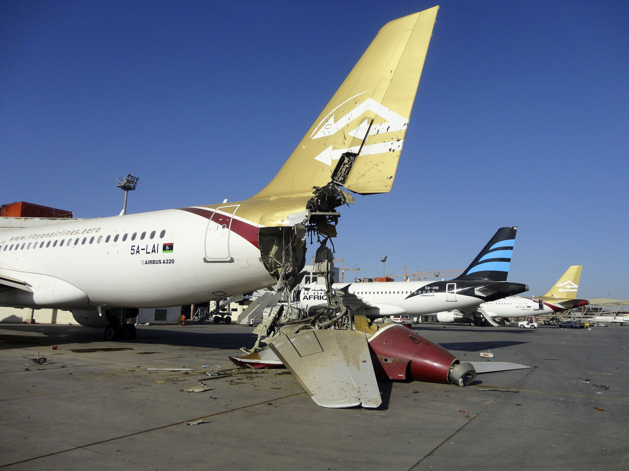 A damaged aircraft is pictured  on Aug. 24 after shelling at Tripoli International Airport