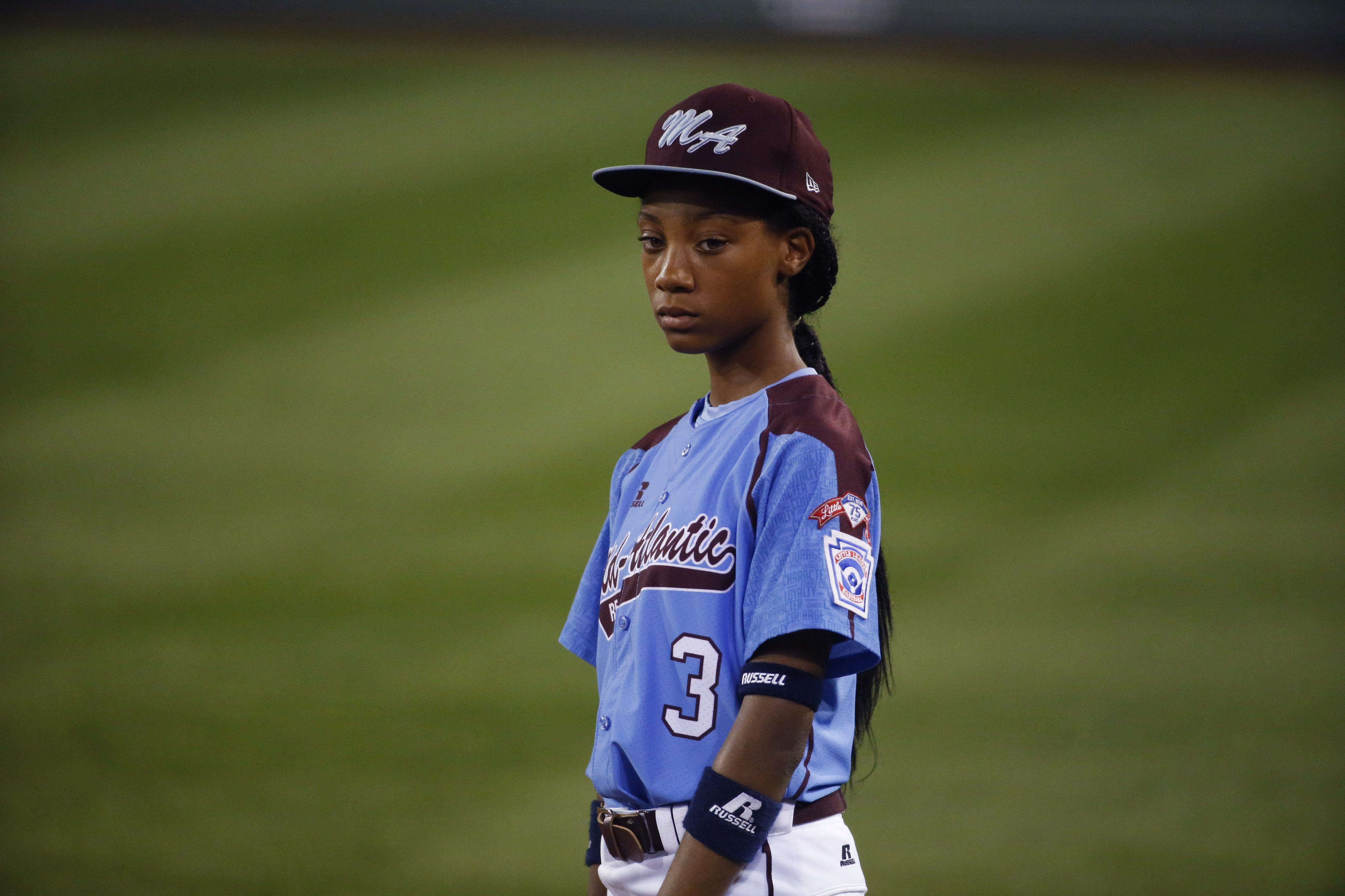 Philadelphia's  Mo'ne Davis pauses during a play review at the second inning of an elimination baseball game against Chicago at the Little League World Series tournament in South Williamsport, Pa., on Aug. 21, 2014. Chicago won 6-5