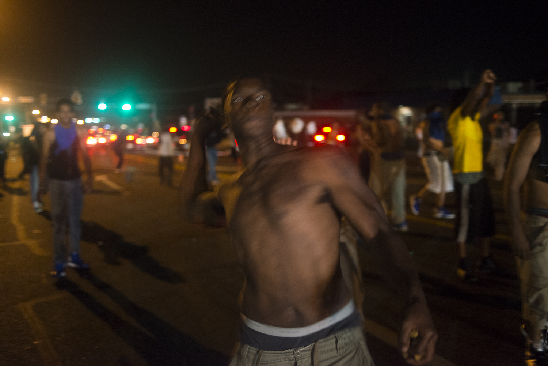 A protestor retaliates against police in Ferguson, Mo. on Aug. 17, 2014.