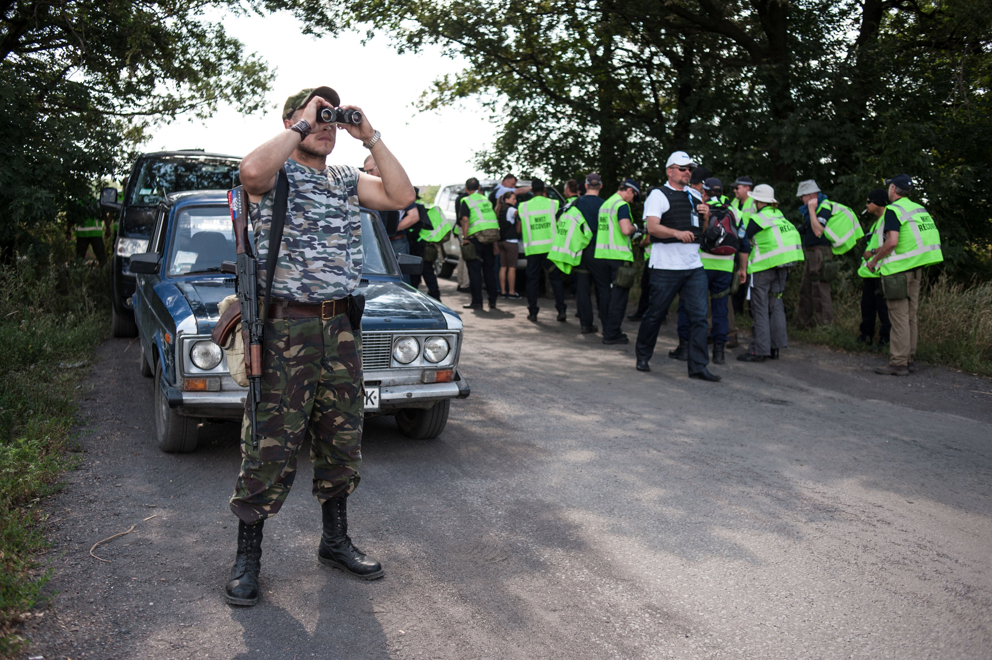 A pro-Russian guards the road as Australian, Malaysian and Dutch investigators prepare to examine the area of the downed Malaysia Airlines Flight 17, near the village of Rossipne, Donetsk region, eastern Ukraine on August 5, 2014.