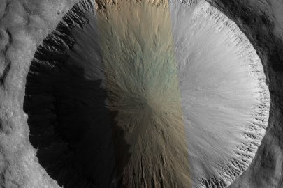 The 4 kilometer (2.5 mile) diameter crater in this image appears relatively fresh, but not remarkably so.