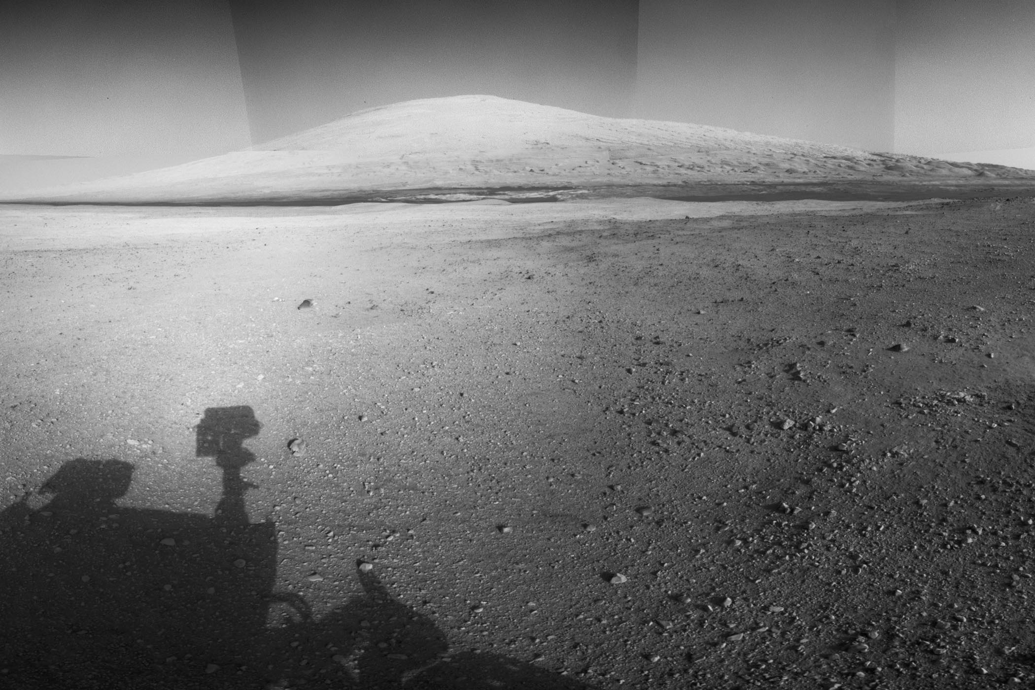 The highest point on Mount Sharp is visible from the Curiosity rover on Aug. 18, 2012. The Martian mountain rises 3.4 miles above the floor of Gale Crater. Geological deposits near the base of Mount Sharp are the destination of Curiosity's Mars mission.