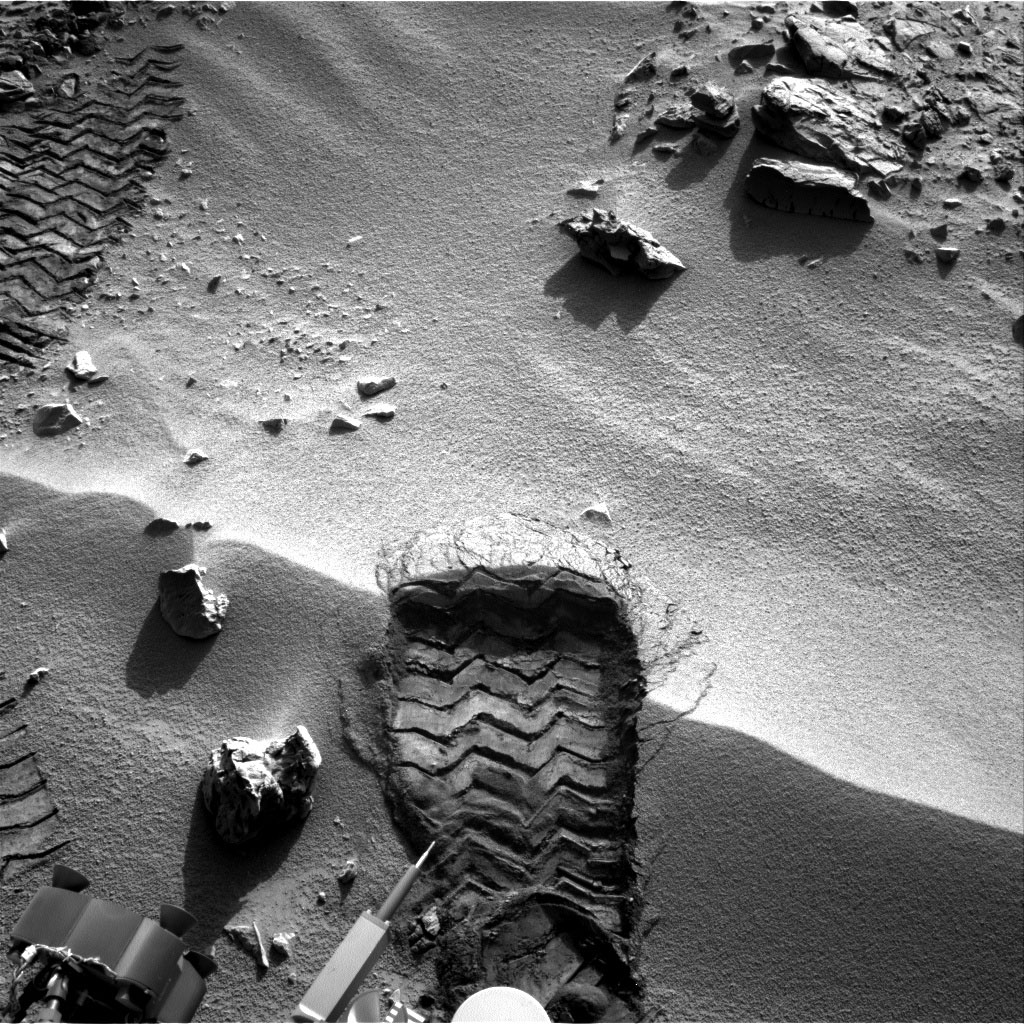 """NASA's Mars rover Curiosity cut a wheel scuff mark into a wind-formed ripple at the """"Rocknest"""" site to examine the particle-size of the ripple. For scale, the width of the wheel track is about 16 inches (40 centimeters)."""