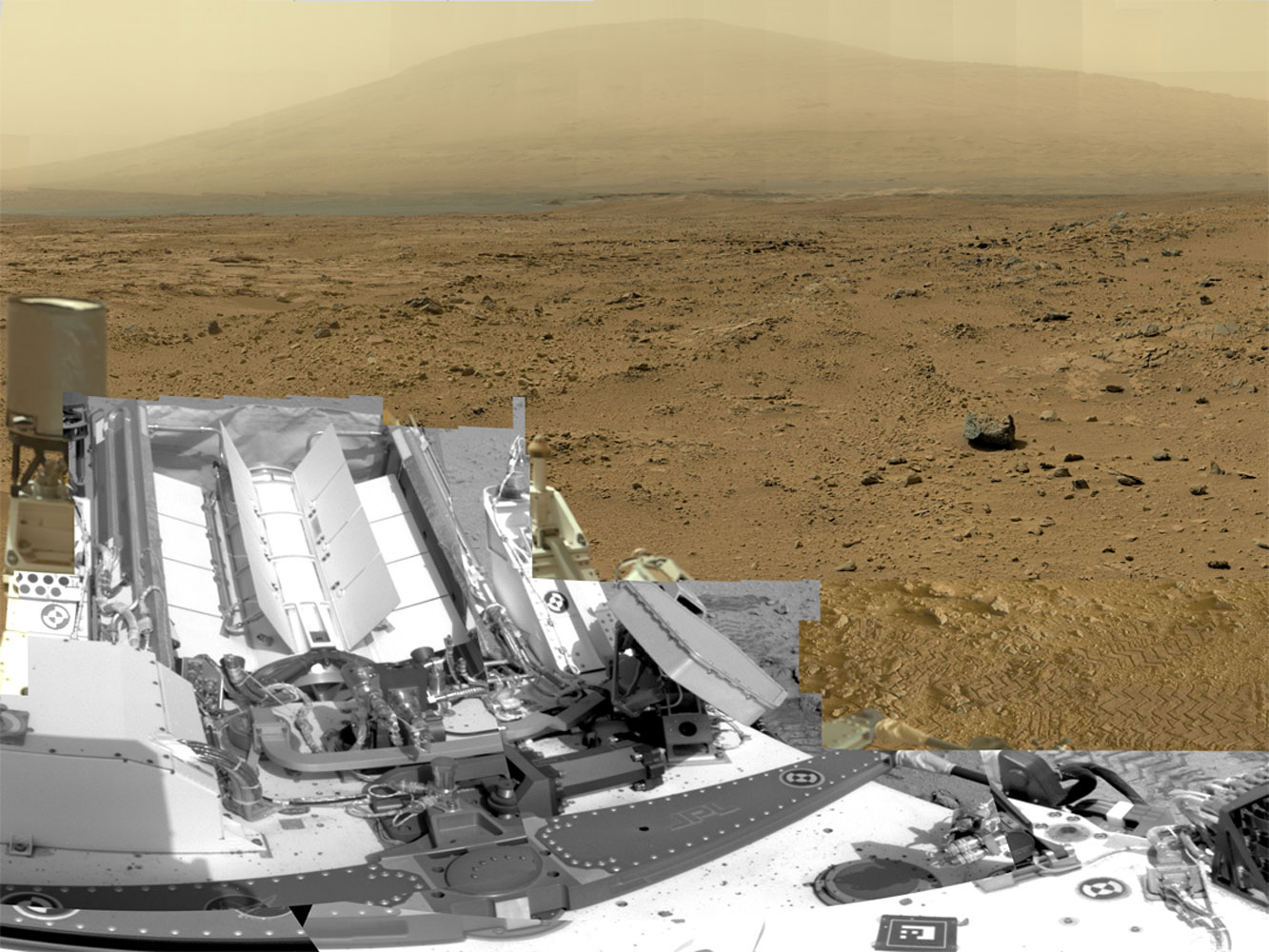 """A full-circle view released by NASA on June 20, 2013, combined nearly 900 images taken by NASA's Curiosity Mars rover, <a href=""""http://mars.nasa.gov/multimedia/interactives/billionpixel/"""">generating a panorama</a> with 1.3 billion pixels in the full-resolution version. The view is centered toward the south, with north at both ends. It shows NASA's Mars rover Curiosity at the 'Rocknest' site where the rover scooped up samples of windblown dust and sand."""